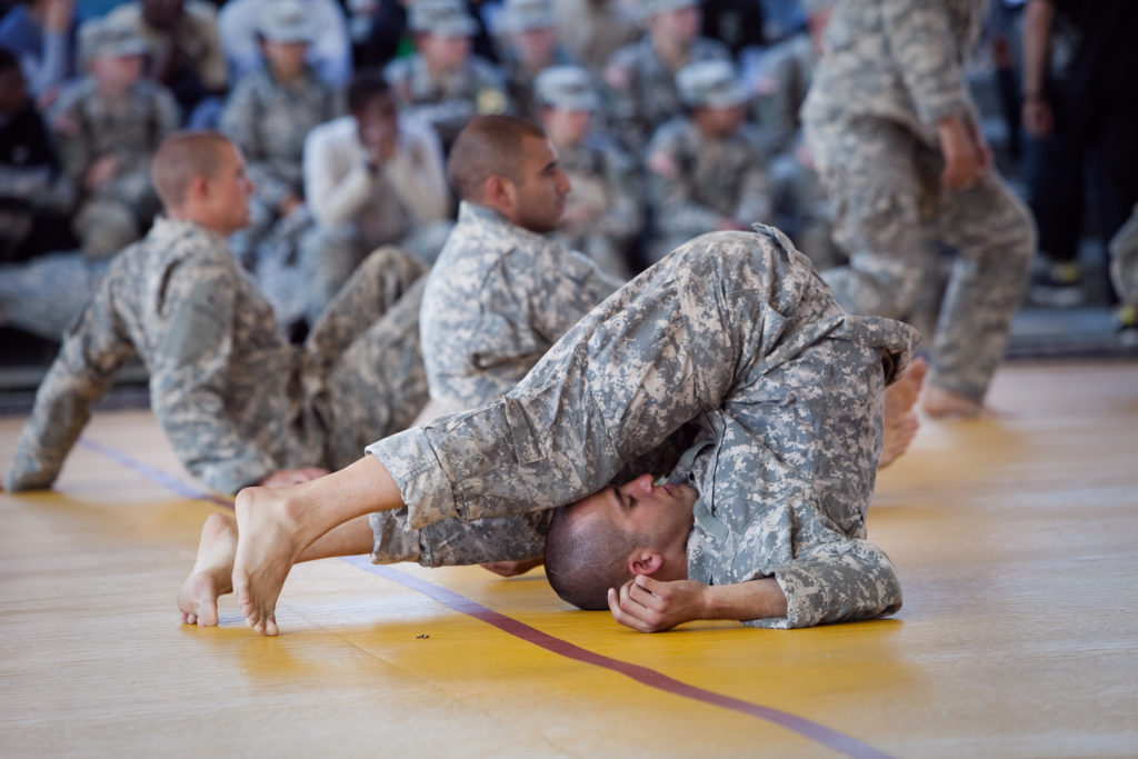 U.S. Army Materiel Command Noncommissioned Officer of the Year Sgt. Douglas McBroom, foreground, stretches and warms up prior to the start of the Department of the Army Best Warrior Competition double-elimination combatives tournament at Fort Lee, Va., Oct. 7, 2011. (U.S. Army phot